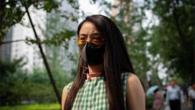 Woman with protective face mask in Beijing