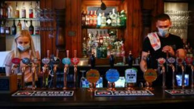 Bar staff in mask