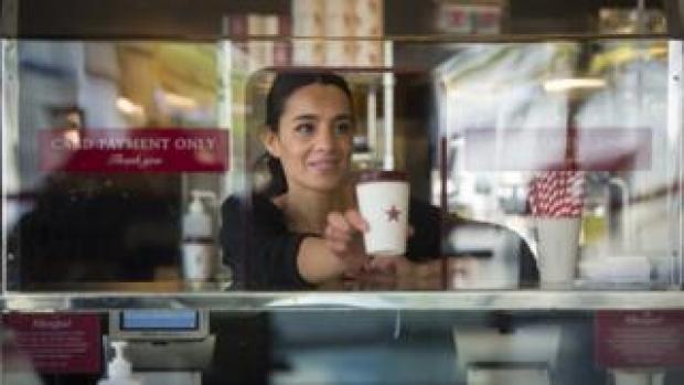 Pret barista serving coffee
