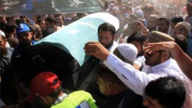 """Relatives and residents carry the coffin of slain Pakistani exchange student Sabika Sheikh, who was killed during a school shooting in Texas, following her body""""s arrival from the United States, in Karachi on May 23, 2018"""
