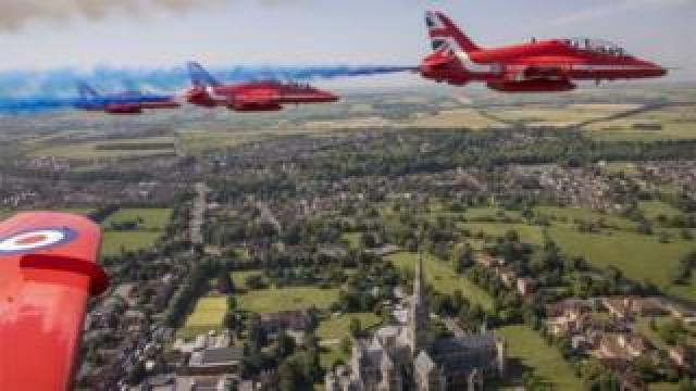 Armed Forces Day is marked by a Red Arrows flypast over Salisbury Cathedral.