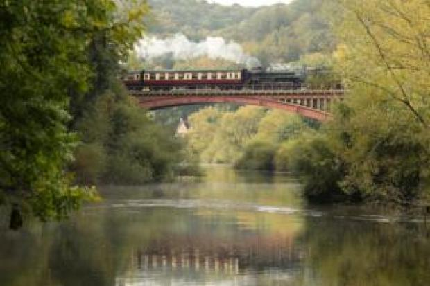 A steam train travelling over the Victoria Bridge between Bewdley and Arley on the Severn Valley Railway in Worcestershire