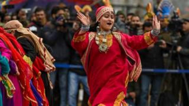 Youths dance during the Republic Day parade at Sher-i-Kashmir cricket Stadium in Srinagar on 26 January 2020.