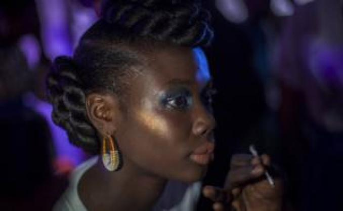 A model has her make-up done backstage during Dakar Fashion Week in Dakar, Senegal