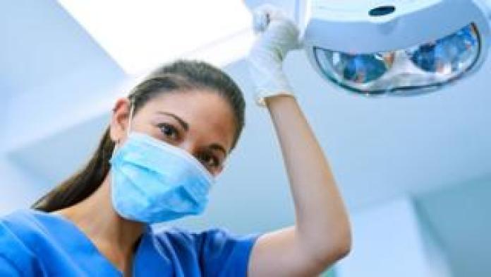 Dental staff wearing a face mask