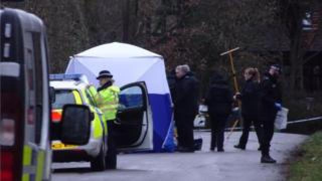 Police officers and tent
