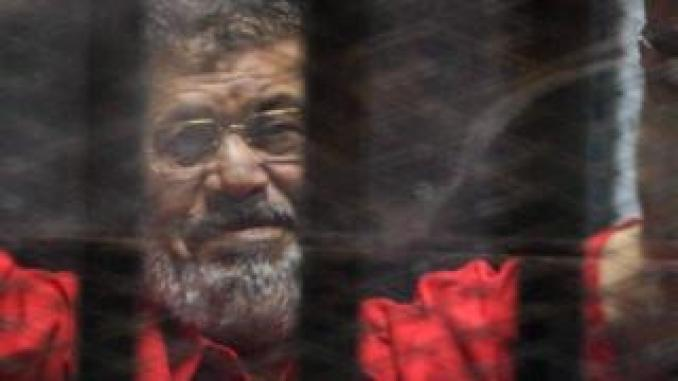 Ousted Egyptian President Mohamed Morsi looks on during a trial session on charges of espionage in Cairo,