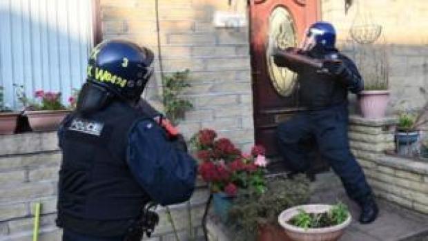 police officers raiding a house