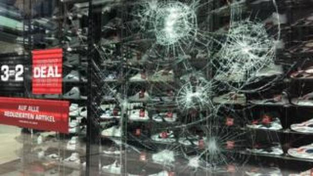 Windows Phone: Smashed sports shop window in Stuttgart, 21 Jun 20