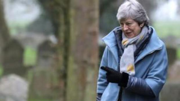 Theresa May leaves church, near High Wycombe, on Sunday