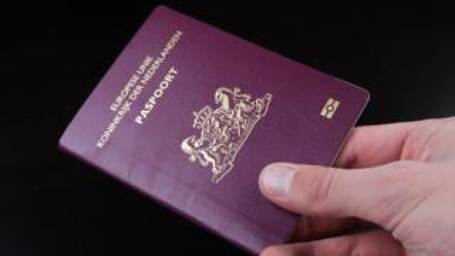 A person holds a Dutch passport