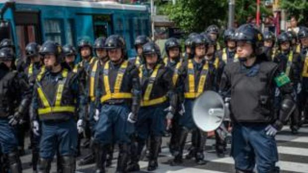Police officers look on during a protest against President Donald Trump's forthcoming meeting with Emperor Naruhito, on May 26, 2019 in Tokyo, Japan