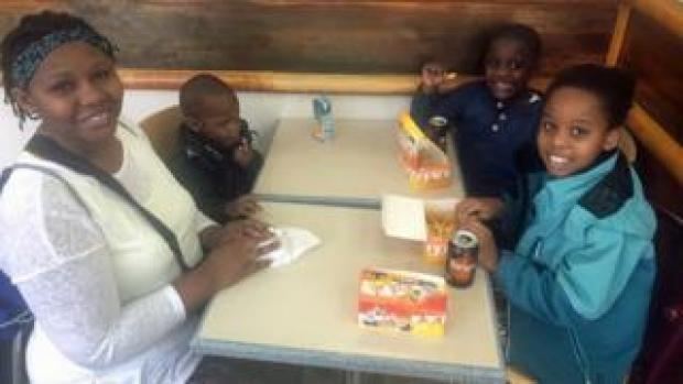 Jackie Mudimi and her children in Chicken Cottage