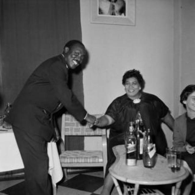 Roger DaSilva shakes hands with US jazz singer Ella Fitzgerald in a self-timed photograph.