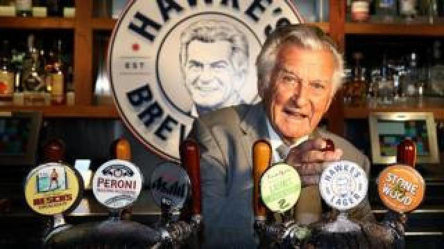 Bob Hawke pours Hawke's Lager at the launch of Hawke's Lager at The Clock Hotel in Sydney, Australia