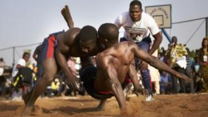 A Malian wrestler brings down his opponent according to the rules of the traditional wrestling during the traditional wrestling festival in Bamako, Mali -Sunday 7 April 2019