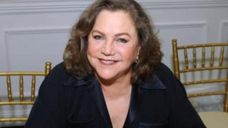 Kathleen Turner smiles sitting down in March 2018 event