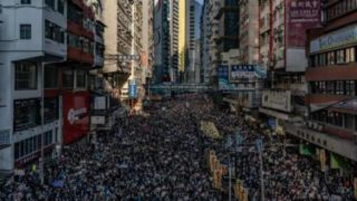 Tens of thousands march through Hong Kong