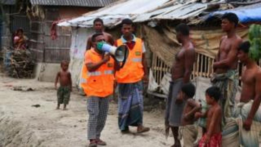 A Cyclone Preparedness Programme (CPP) volunteer uses a megaphone to urge residents to evacuate to shelters ahead of the expected landfall of cyclone Amphan in Khulna in Bangladesh on May 19, 2020.
