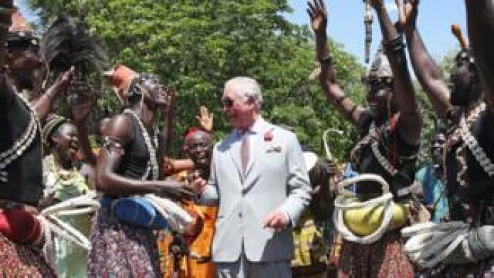 Prince Charles, Prince of Wales is greeted by the traditional dancers during a tour of Christiansborg Castle on November 3, 2018 in Accra, Ghana