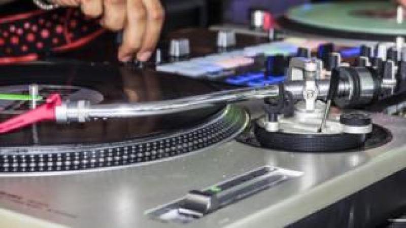 A close-up of a DJ at work
