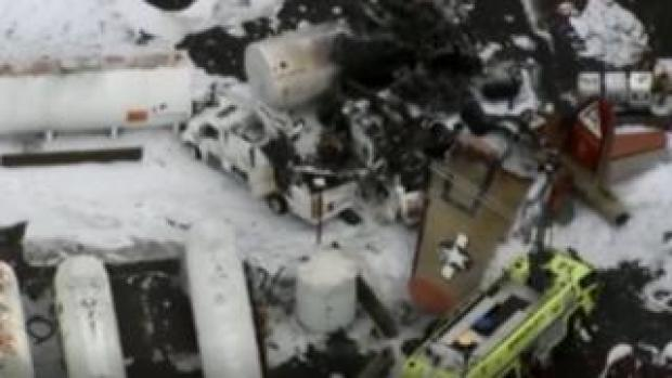 A plane wing is seen among the wreckage
