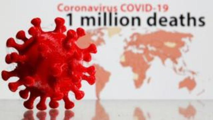 A 3D printed coronavirus model is seen in front of the words