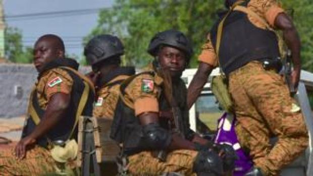 A picture take in Octtober 2018 shows Burkinabe gendarmes sitting on their vehicle in the city of Ouhigouya in the north of the country.