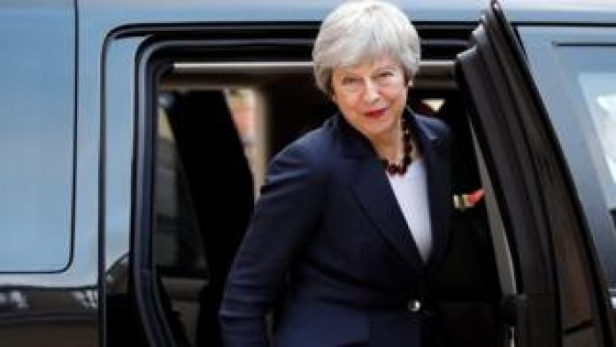 Theresa May leaves after a meeting with French President Emmanuel Macron to discuss Brexit on Tuesday at the Elysee Palace in Paris,