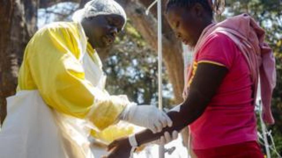 NEWS A nurse takes care of cholera patients during a visit of Zimbabwe Minister of Health,