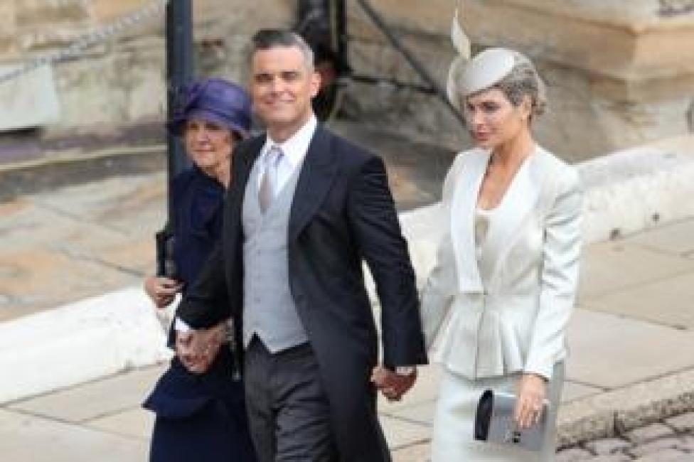 NEWS Robbie Williams and Ayda Field (right) arrive for the wedding of Princess Eugenie to Jack Brooksbank at St George's Chapel in Windsor Castle