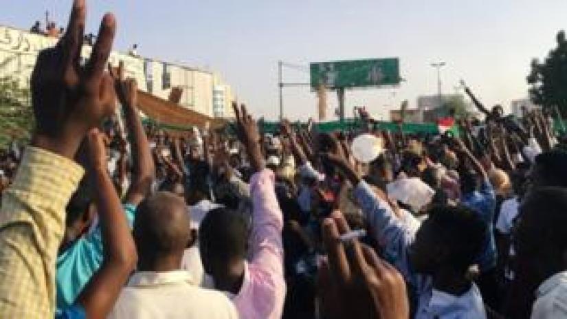 Sudanese demonstrators chant slogans during a protest demanding Sudanese President Omar Al-Bashir to step down