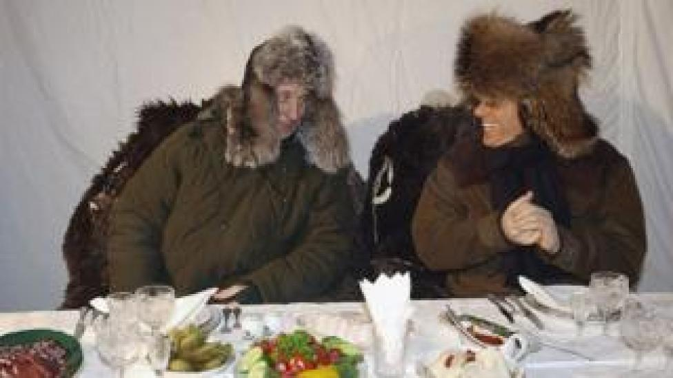 Putin and Berlusconi in warm winter outfits on a trip to a wildlife preserve north of Moscow in 2003