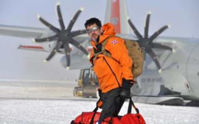 Justin in the snow with bags
