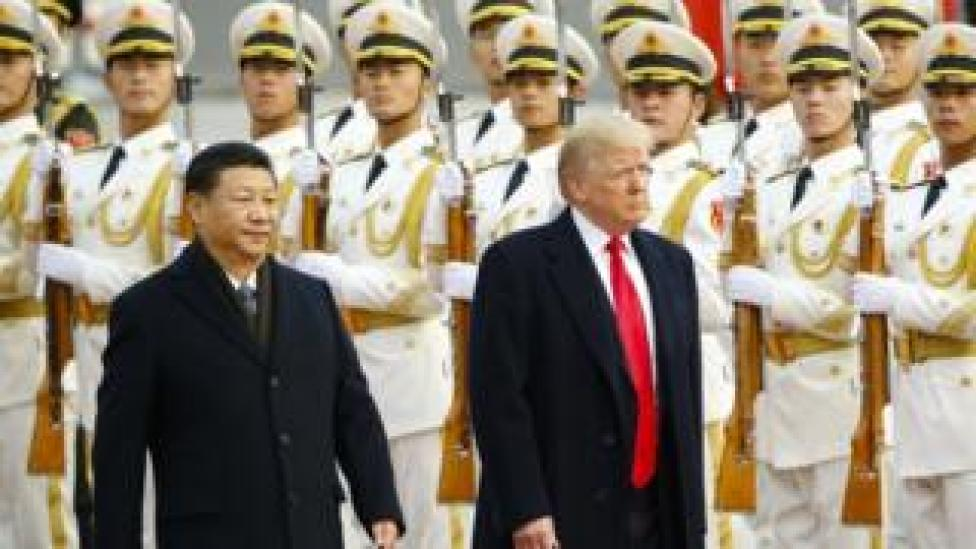 US President Donald Trump takes part in a welcoming ceremony with China's President Xi Jinping on 9 November, 2017 in Beijing, China.