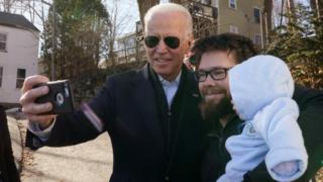 Democratic presidential candidate and former Vice President Joe Biden greets a man with his baby after a campaign event in Somersworth, New Hampshire, U.S., February 5, 2020
