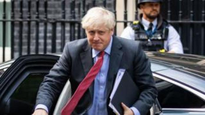 Boris Johnson arriving back at Downing Street