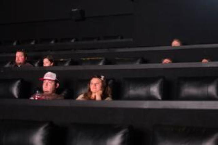 People are sitting in a cinema
