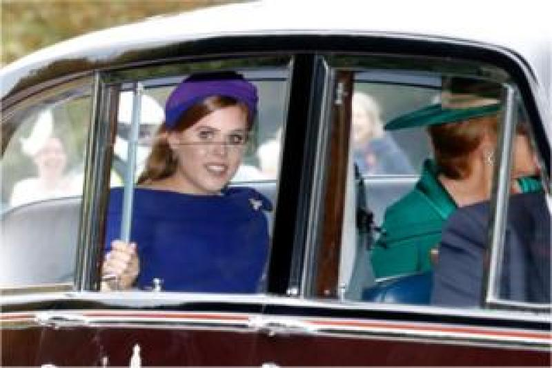 Princess Beatrice of York and her mother Sarah Ferguson (R) arrive in their car to the Royal wedding