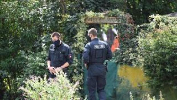 Police works at the site where they started digging in an allotment area near Hanover, Germany July 29, 2020