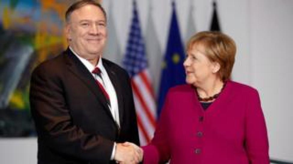 German Chancellor Angela Merkel shakes hands with US Secretary of State Mike Pompeo during a news conference in Berlin, Germany November 8, 2019