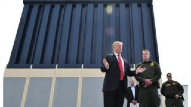 US President Donald Trump inspects a prototype of the wall he hopes to build across the US-Mexico border