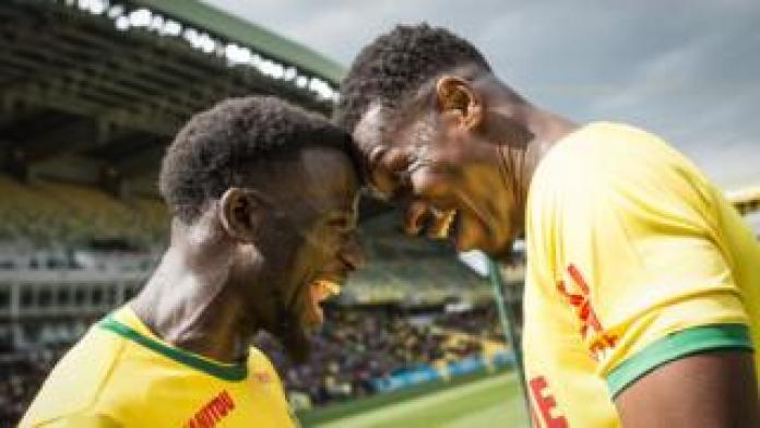 Nantes' Malian forward Kalifa Coulibaly (R) celebrates with Nantes' French midfielder Abdoulaye Toure after scoring a goal during the French L1 football match between Nantes (FCN) and Dijon (DFCO) at the Beaujoire stadium in Nantes, on May 5, 2019.