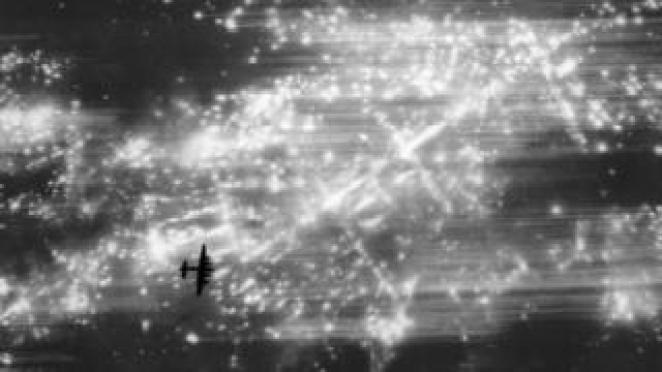 An RAF bomber over Hamburg, 1943