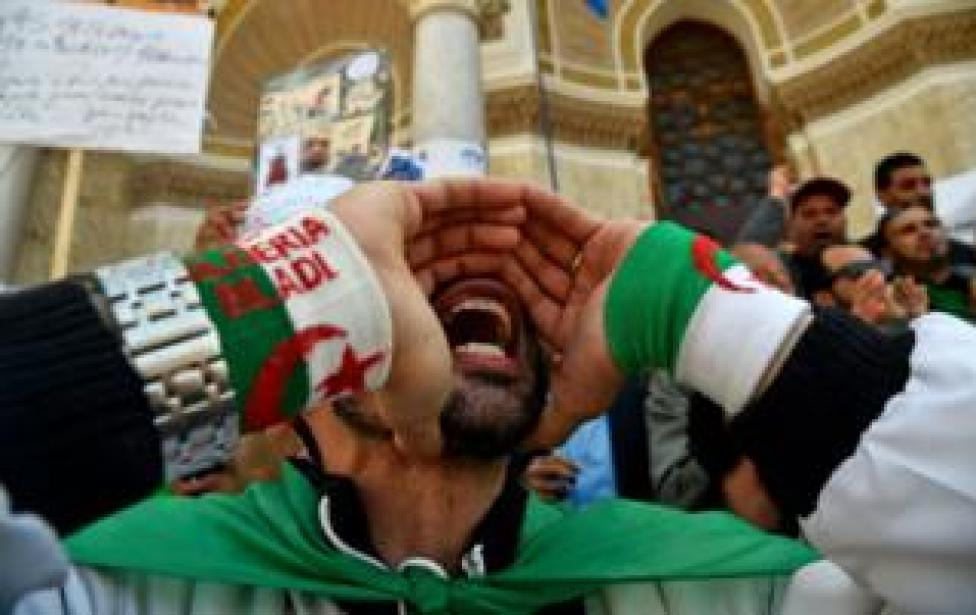 Algerian protestors shout slogans during a demonstration marking May Day in Algiers on May 1, 2019.