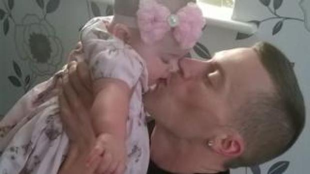 Michael Luciw with his baby daughter