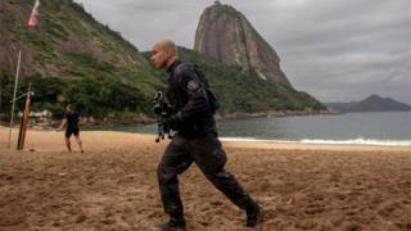 A member of the military police, patrols during a police operation in Vermelha beach at Urca neighbourhood, Rio de Janeiro, Brazil, on June 8, 2018