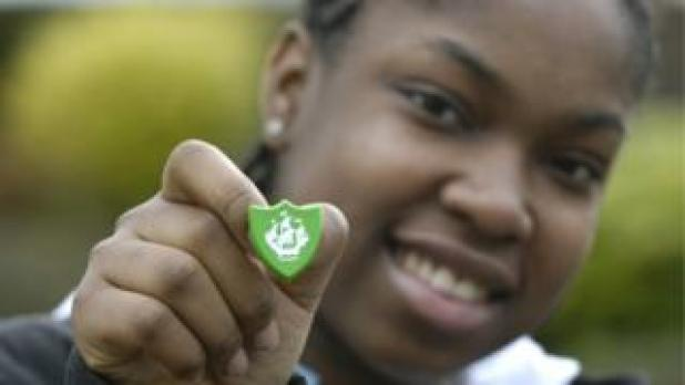 A boy with a Blue Peter badge