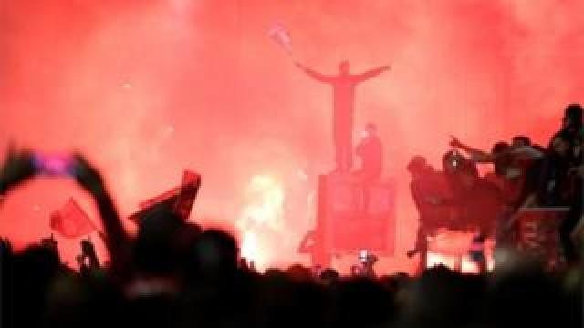 Fans celebrate outside Anfield