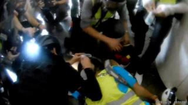 Veby Mega Indah is given aid after being shot